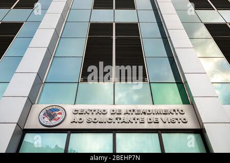 Modern contemporary architecture of the visa request center with reflection of the sky and United States emblem. TRANSLATION: 'VISA REQUEST CENTER' - Stock Photo