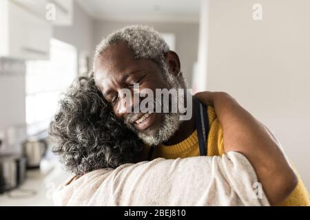 A senior African American couple spending time together at home