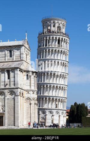 Pisa, Italy - March 31 2019: The Leaning Tower of Pisa (Italian: Torre pendente di Pisa) is the campanile of the Pisa Cathedral.