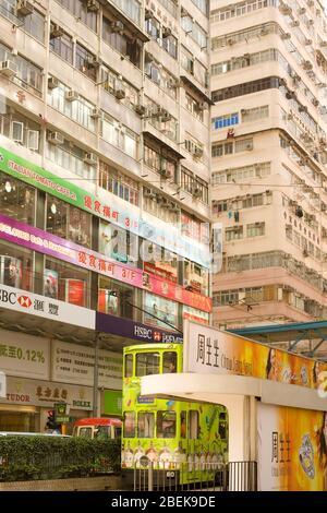 Causeway Bay, Hong Kong Island, Hong Kong, China - Traditional tram and store signs in a street view. - Stock Photo