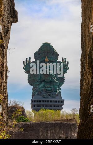 Vertical view of the GWK statue at Garuda Wisnu Kencana Cultural Park in Bali, Indonesia.