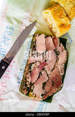 Jambon Persillé, or Parsley Ham - ham hock made into a terrine with parsley in aspic. A local food from the region of Burgundy. Dijon, France. 2020. - Stock Photo