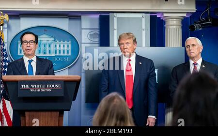 Washington, United States Of America. 13th Apr, 2020. Washington, United States of America. 13 April, 2020. U.S. Secretary of the Treasury Steven Mnuchin, left, joined by President Donald Trump, and Vice President Mike Pence, responds to a question from reporters during the daily COVID-19, coronavirus briefing in the Press Briefing Room of the White House April 13, 2020 in Washington, DC. Credit: D. Myles Cullen/Education Department/Alamy Live News Stock Photo