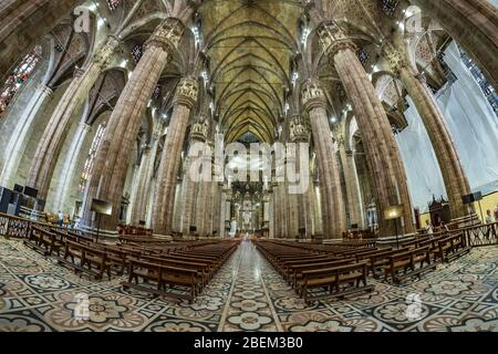 MILAN, ITALY - AUG 1, 2019: Interior of the famous Cathedral Duomo di Milano on piazza in Milan, Italy. Fish eye lens shot. - Stock Photo