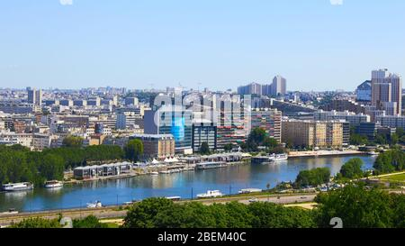 Paris, France - August 26, 2019: Paris from above showcasing the capital city's rooftops, the Eiffel Tower, Paris tree-lined avenues with their - Stock Photo