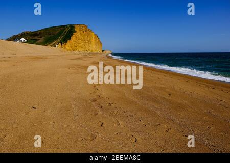 West Bay, Dorset, UK. 14th Apr, 2020. As the Coronavirus lockdown continues and tourist stay away from the normally crowded resort of West Bay the Office for Budget Responsibility says that the lockdown could shrink the GDP by 35%. Credit: Tom Corban/Alamy Live News