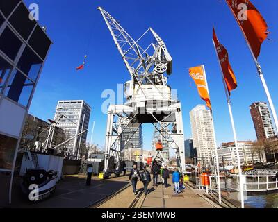 naval maritime museum with ships and boats on water in the river at the port of rotterdam in netherlands - Stock Photo