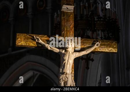 Close up of a sculpture of Jesus Christ on the cross at the Basilica of Our Lady of the Rosary in Lourdes, France, Europe - Stock Photo