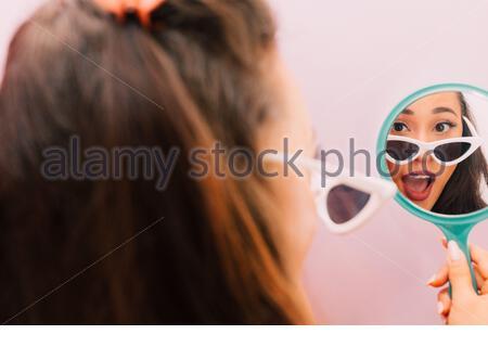 Portrait of Multiracial Female Pink Background White Sunglasses - Stock Photo