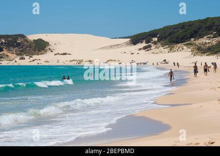 Bolonia, Costa de la Luz, Cadiz Province, Andalusia, southern Spain.  Bolonia beach.  Playa de Bolonia.  In the background is the Bolonia sand dune, o - Stock Photo