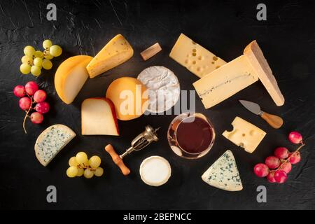 Cheese and wine, shot from the top on a black background - Stock Photo