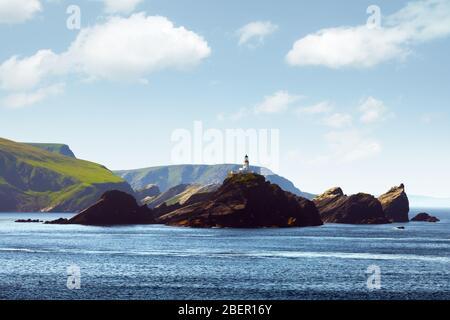 Seascape with lighthouse on the isle Muckle Flugga, United Kingdom, Scotland, Shetland Islands. Landscape photography - Stock Photo