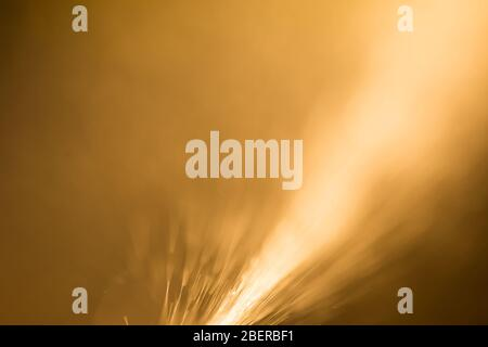 Abstract orange lights like sparkles of fire - Stock Photo