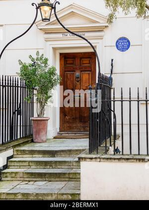 House in 13 Holland St., Kensington and Chelsea with English Heritage Blue Plaque marking residence of Walter Crane, artist and children's illustrator - Stock Photo