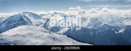 The grandiose and amazing panoramic view of freeze mountain range Alpes landscape scene from the highest nature peak panorama viewpoint. French Alps - Stock Photo