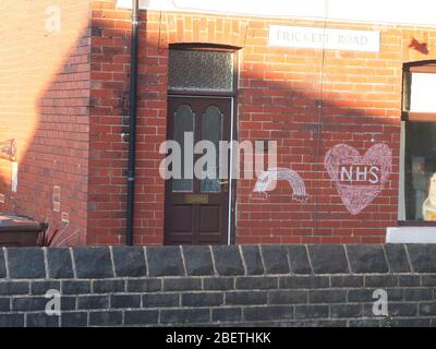 A message of support and gratitude to the NHS with a rainbow chalked on the wall of a house on Trickett Road, Sheffield during the Coronavirus crisis