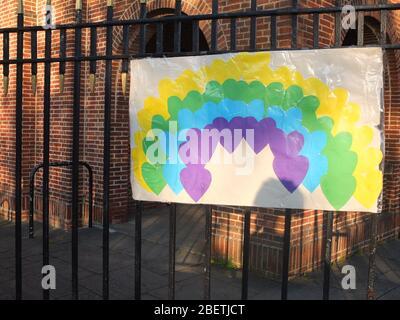 A sign of hope of a rainbow made of hearts on the railings of Scared Heart Catholic Church, Hillsborough, Sheffield, UK, closed due to Coronavirus