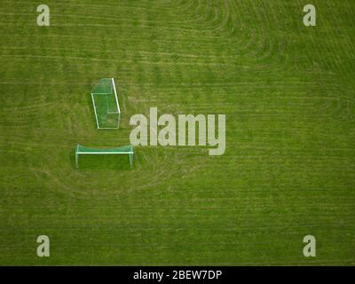 Aerial shot of football goals on an empty field - Stock Photo