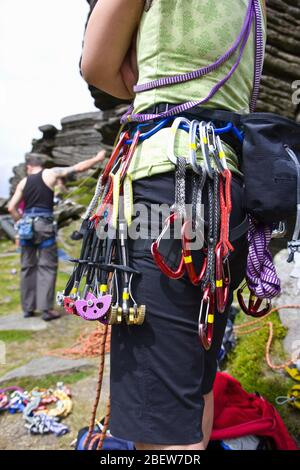 close up of climbing gear on rock climbing harness - Stock Photo