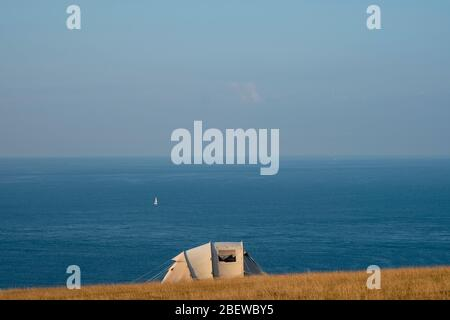 Campers on field in East Prawle, Devon, summer - Stock Photo