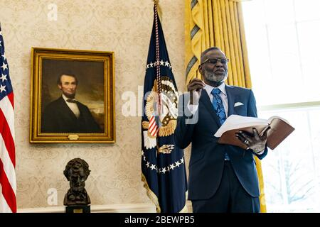 Washington, United States Of America. 10th Apr, 2020. Bishop Harry R. Jackson, Jr., offers an Easter blessing Friday, April 10, 2020, in the Oval Office of the White House People: Bishop Harry R. Jackson, Jr. Credit: Storms Media Group/Alamy Live News - Stock Photo