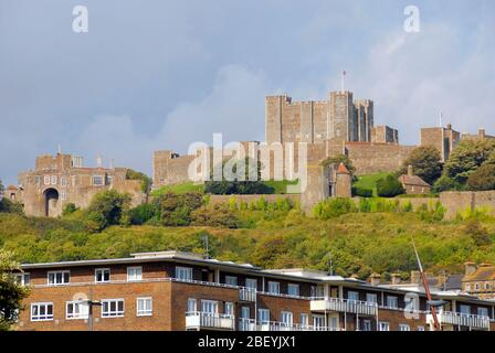 Dover castle, Kent, contrasted against  a more crowded lifestyle living in modern appartment block - Stock Photo
