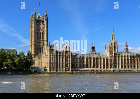 The Palace of Westminster with the Victoria Tower landmark and House of Lords, Houses of Parliament from the River Thames, London, United Kingdom