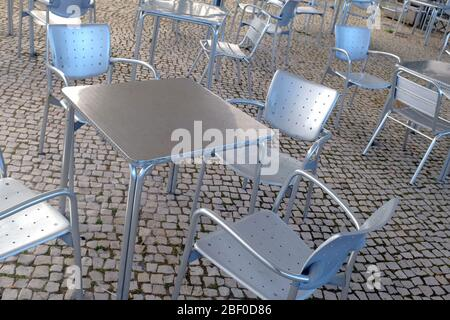Empty modern silver chairs and tables in a terrace - Stock Photo