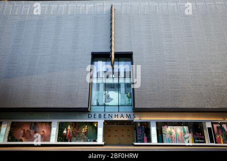 London, U.K. - 16 Apr 2020: The entrance to the Debenhams store on an empty Oxford Street, which has been boarded up during the Covid-19 coronavirus pandemic lockdown.