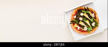 banner of Vegan pizza asparagus in a box for delivery, advertising or menu - Stock Photo