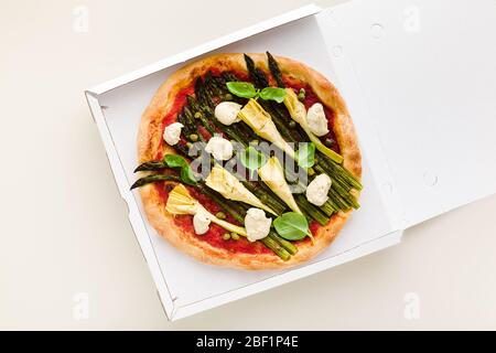 Vegan pizza asparagus in a box for delivery, advertising or menu - Stock Photo