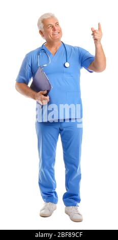 Portrait of male doctor showing something on white background - Stock Photo