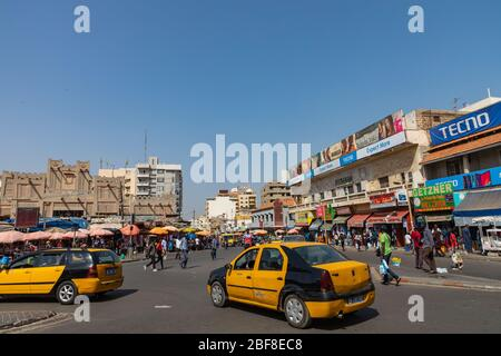 DAKAR, SENEGAL - NOVEMBER 11, 2019: People working and traffic at Senegal capital Dakar, West Africa.