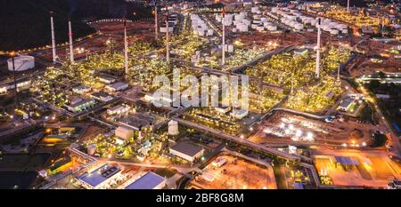 Aerial view of Oil refinery plant in twilight time. Refinery industrial zone. crude oil and gas refining industry at Thailand