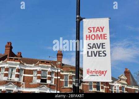 banners in haringey tell the public to stay home and save lives during the corona pandemic lockdown in london england UK - Stock Photo