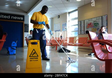 A Hospital cleaner, mopping the floor - Stock Photo