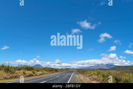 View towards cloud covered Mount Ngauruhoe and Mount Ruapehu from highway SH47, Tongariro National Park, New Zealand - Stock Photo