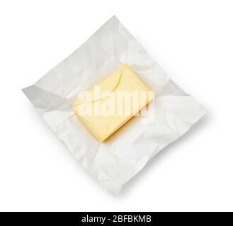 Piece of butter on package paper isolated on white background. Top view of butter. - Stock Photo