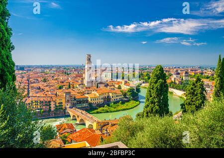Aerial view of Verona historical city centre, Ponte Pietra bridge across Adige river, Verona Cathedral, Duomo di Verona, red tiled roofs, Veneto Regio