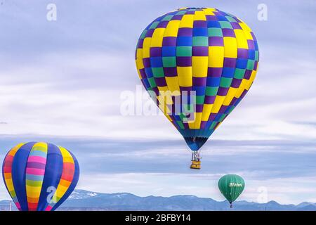 Multiple hot air balloons at take off in Al - Stock Photo
