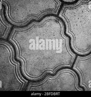 A black and white close up view of some ceramic kitchen floor tiles - Stock Photo