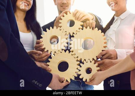 Group of businessmen with gears at the table at the workplace in the office.