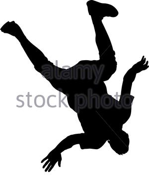 Man performs a jump with a flip back silhouette - Stock Photo