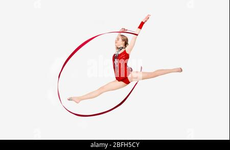 Female gymnast with string leaping in air, isolated on white - Stock Photo