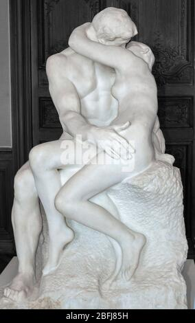 The Kiss a white marble sculpture by Auguste Rodin in the Rodin Museum (Musee Rodin), Paris, France, Europe - Stock Photo