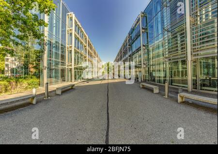 Bern, Switzerland - July 30, 2019: A modern metal concrete and glass mounted building in the Swiss Capital. Panoramic. View at sunny summer day. - Stock Photo