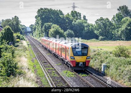 South West Tains Desiro City No. 707003 approaches Chertsey station, Surrey, England, UK - Stock Photo