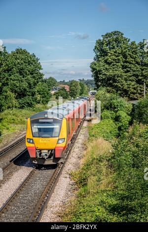 South West Trains Desiro City No. 707008 departs from Chertsey station, Surrey, England, UK - Stock Photo