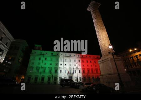 Roma, Italy. 18th Apr, 2020. Rome, Italy. A view of Palazzo Chigi, official residence of the Prime Minister of Italy illuminated with the colors of the italian flag in Rome on April 19, 2020 during the Covid19 outbreak. (Photo by Giuseppe 'Pino' Fama/Pacific Press) Credit: Pacific Press Agency/Alamy Live News - Stock Photo