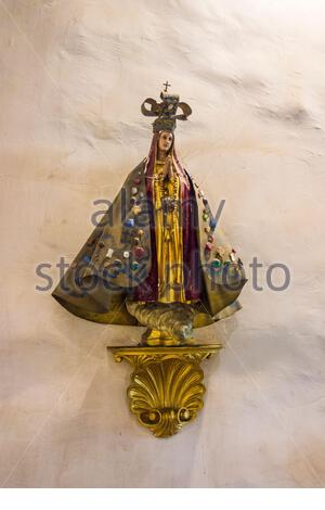 Statue of Our Lady of San Juan de los Lagos on a wall of The Ávila Adobe, built in 1818 by Francisco Ávila,the oldest standing residence in California - Stock Photo